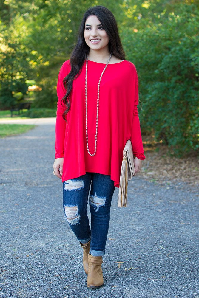 PIKOut your favorite PIKO! Everybody's favorite must-have top is back and in SO many colors! Add this bright red colored boatneck top to your wardrobe for undeniable beauty and all day comfort! Dress