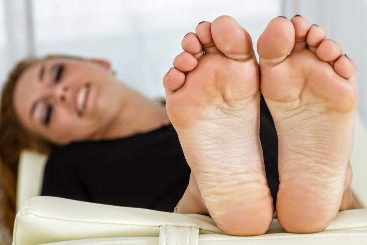 Hispanic female feet, tickling the soles of bare feet