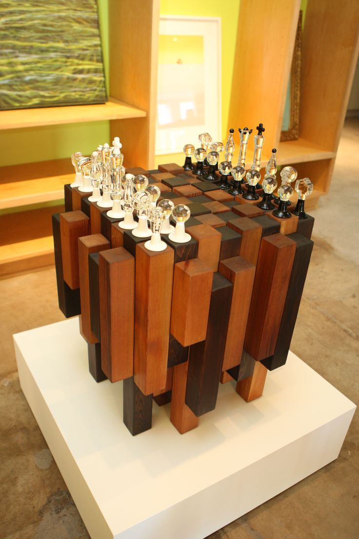Collaborative functionalabstract chess board privately commissioned. Wood base built and designed by Reagan Johns.Features 32borosilicate glass pieces on cedar with hidden pull out draws for storing each piece. Comments comments