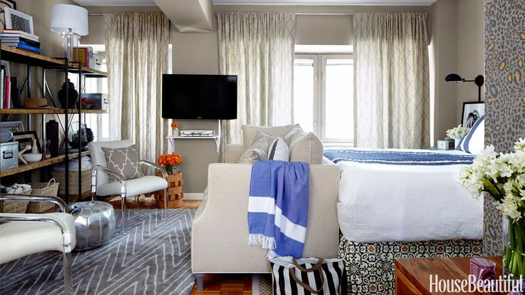 """1. Use All Available Space — Even on the WallsStewart mounted the Samsung TV on a swing-arm device, eliminating the need for a bulky media center. It swivels to face the bed and pushes back flush when not in use. Sconces by the bed free up space on the surfaces of the bedside tables. 2. Think About the Room in Terms of ZonesThe Benchmade by Brownstone sofa """"is like a pretend wall between the living area and bedroom,"""" Stewart says. Comple-mentary rugs reinforce the idea that the area has…"""