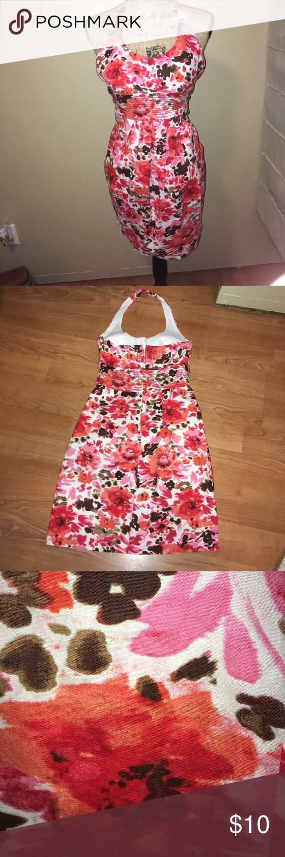 """B. Smart floral print sundress. Used size 5/6 Floral print dress w/strap around neck. Small elastic band at center part of neck. Ruching in chest area. Built in padded bra. Pleated down front under band that goes under chest. Hidden side front pockets on either side of pleats . Fitted and very small wouldn't zip up on mannequin. Oranges, pinks, browns, and white colors.  Waist band under breasts 12"""" across: underarms across 13-1/2"""" center of Neck strap to bottom of dress 35-3/4""""  top of back…"""