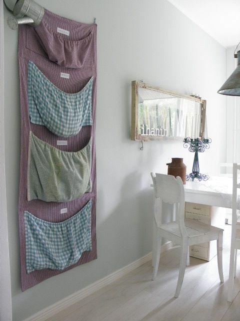 Taskullisessa seinäpussukassa kierrättyy lasi, metalli ja kartonki.