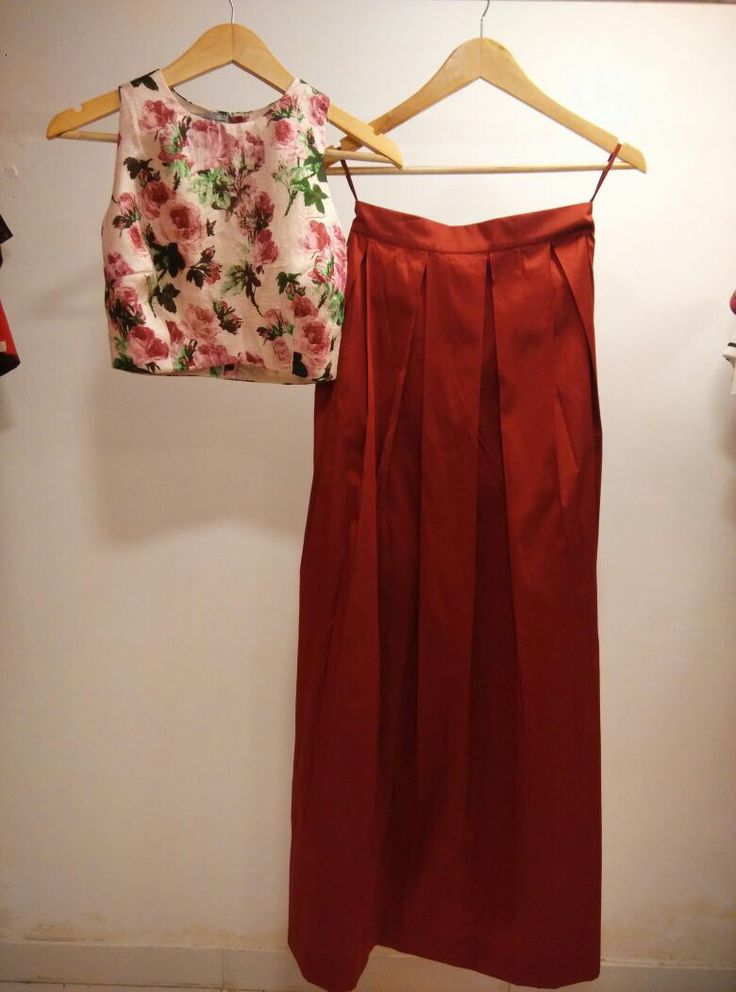 Crop top and skirt.. Raw silk floral print on the top.. Rich wine red color pleated long skirt..
