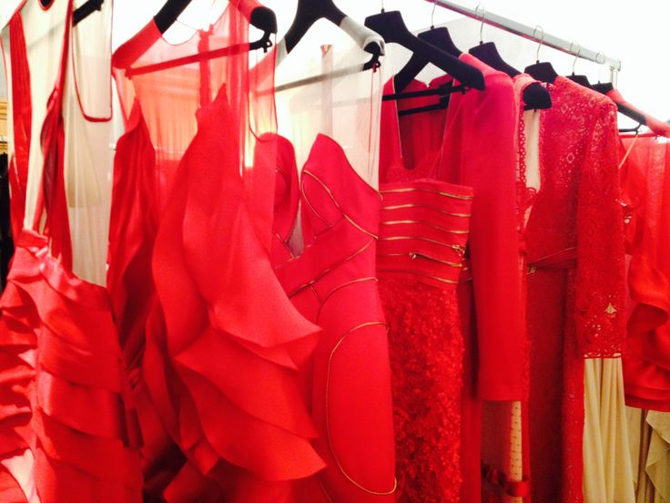 CHRISTOS COSTARELLOS AW 14-15 There's no such thing as too much red! A rack of Christos Costarellos AW14-15 evening gowns from our showroom presentation in Paris! #costarellos #pfw #fashionweek #fashion #reddress #red