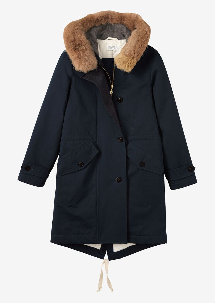 WINTER PARKA | Warm parka in closely woven, water resistant cotton. Quilted cotton inside with wool facing. Large hood, lined in a wool-blend flannel, with detachable fur trim.