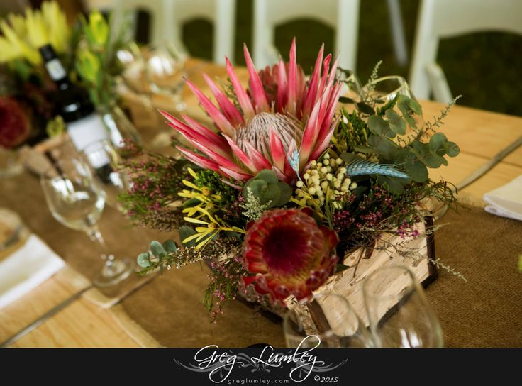 458_coni_f_00006--0.jpg  | Wedding flowers.  Proteas on wooden table.