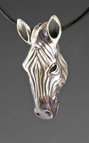 handcrafted silver zebra jewelry, silver zebra totem jewelry.