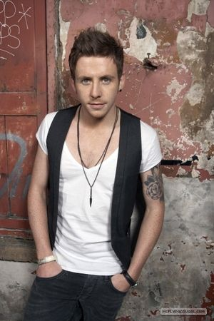#1 favorite band- McFly. 3rd favorite member, Danny Jones, aka the *other* singer/guitarist. Often considered the frontman :P I find it funny that Tom's blonde and he's the brainy one, and Danny's brunette and he's the ditzy, clumsy one.