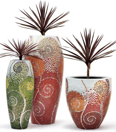 mosaic planters, diy with small cheap beads and such... its that curvy whimsical pattern that is the focal point to duplicate.