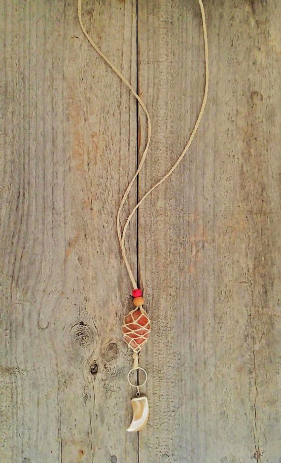 A beautiful piece of polished Sunstone, handwoven into a natural hemp macrame pouch and featuring a carved shell tooth charm. This is a gorgeous casual bohemian style, perfect for adding layered lengths to your look; pair with your fave tee and jeans, or maxi skirt and crop