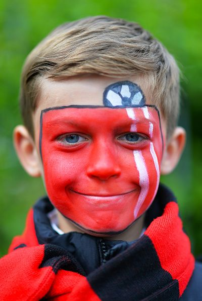 A young Bournemouth fan arrives ahead of the Sky Bet Championship match between Charlton Athletic and AFC Bournemouth at The Valley on May 2, 2015 in London, England.