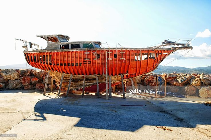 replacing the wooden frame of a motoryatch on ground in ozbek bay,izmir,turkey.all the orange colored pieces are new.
