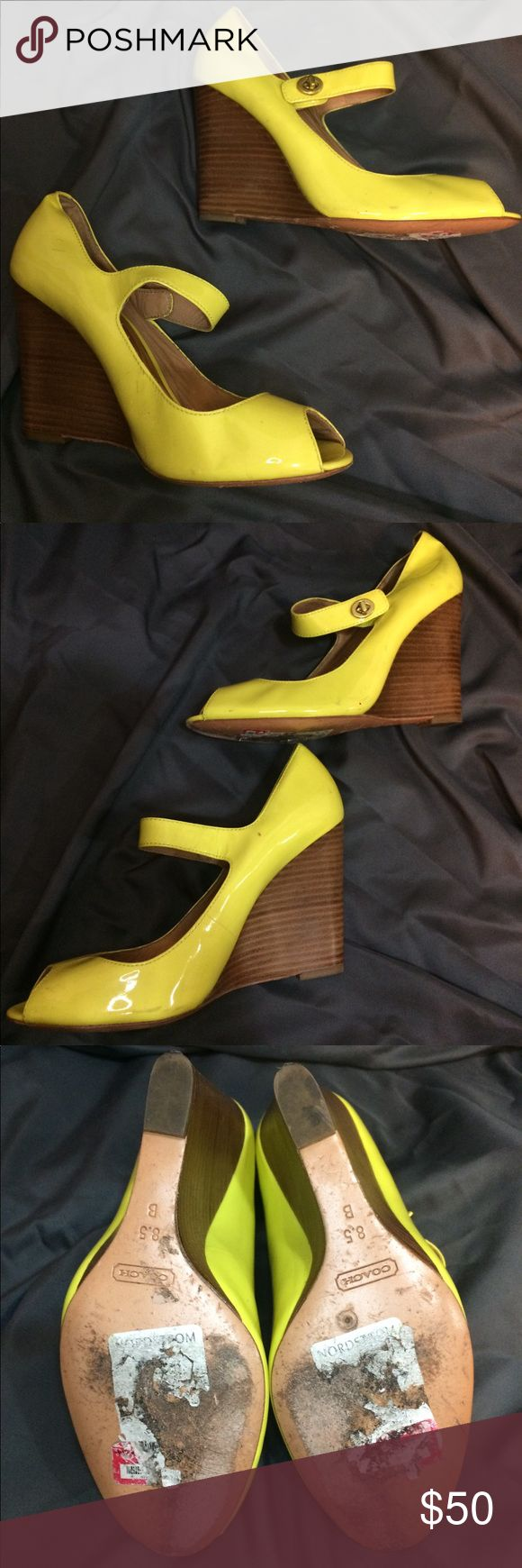 Coach Wedge Sz 8.5 Super cute yellow wedge with classic coach twist lock on ankle strap. Material: Patent Leather. Has damage on the sole and a wrinkle on the left ankle but otherwise in good condition. Reasonable offers considered. Coach Shoes Wedges