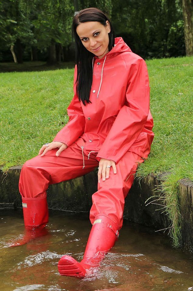 Red rain suit and wellies rubber boots in water
