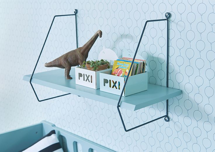 Add atmosphere and a personal touch to the nursery with the wall shelf, in a clean, simple and functional design.   Make full use of the shelf and hang musical toys, clothes hangers, and such from the bottom wire.
