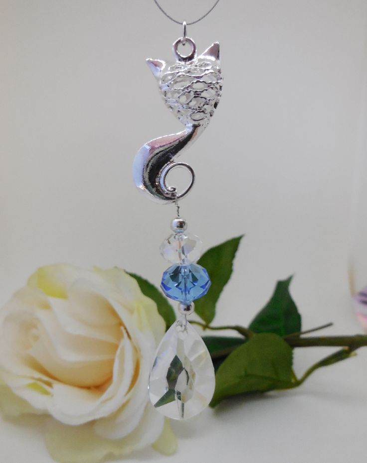 Sun-CAT-Cher Mini, Silvertone Cat with sparkling faceted clear & blue glass beads and faceted acrylic teardrop pendant. Non perishable wire loop for hanging in car or window.