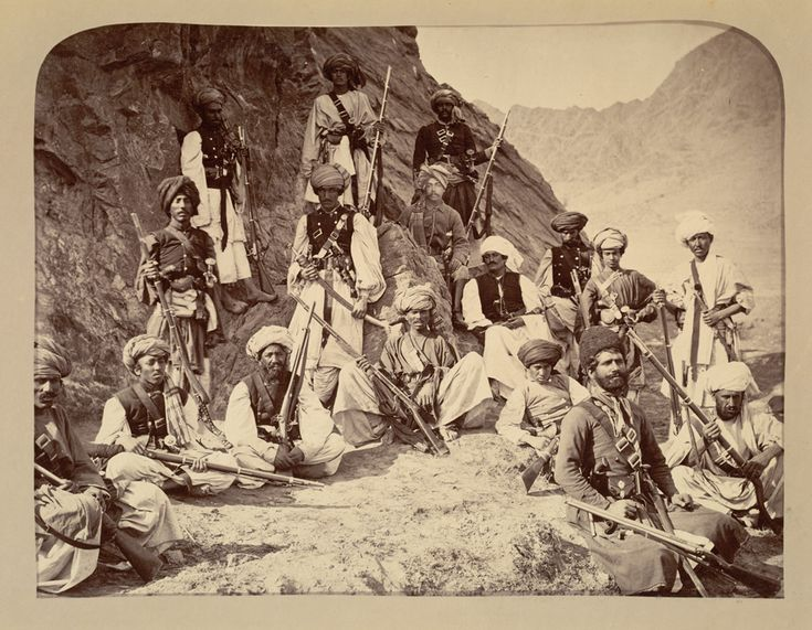 Photograph with Colonel Sir Robert Warburton (1842-1899) sitting amid a group of Afghan warriors, taken by John Burke in 1878. Burke travelled widely as a photographer in the sub-continent, but is best known for his photography during the Second Anglo-Afghan War (1878-80). He accompanied the Peshawar Valley Field Force during the two-year campaign and worked steadily in the hostile environment of Afghanistan and the North West Frontier Province (Pakistan).