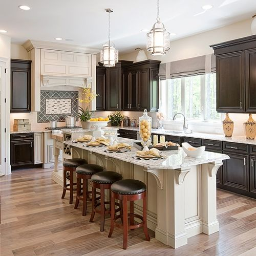 The progress lighting bay court pendants feature nautical styling that unifies this kitchen area by creating a prominent centerpiece above the island