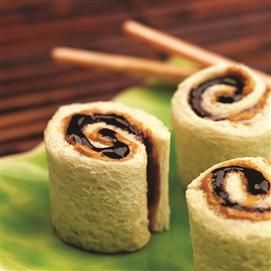 Peanut Butter and Jelly Sushi Rolls: Who wants a plain ole peanut butter and jelly sandwich? Cut off the crusts and roll the sandwiches up to look like sushi rolls to create a fun little lunch.