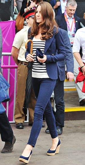 he Duchess chose a navy Smythe blazer, a nautical tee, blue skinny jeans, and matching Stuart Weitzman wedges to cheer on equestrian pro Princess Zara as she competed in the London Olympics