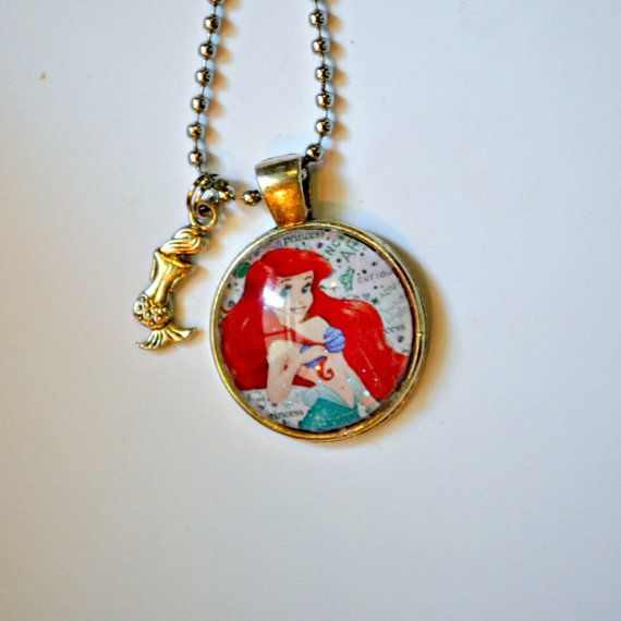 Stay, Under the Sea, with this sparkling Ariel necklace, complete with a mermaid charm! When you order you will get something similar to what is pictured. It may be a different Ariel Image.Pictured is one of about 5 different surprise images, and two different charms that are available. Its a Surprise for what you get! All Disney necklaces come with a sparkle glaze and a 24 ball chain, necklace. (if you would like it how it is pictured please leave comments at time of order, if you would…
