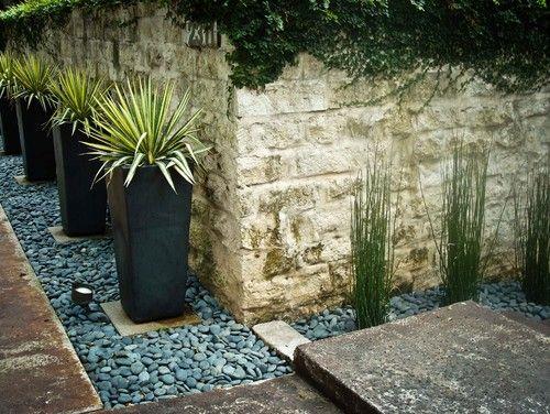backyard against house......Planters contemporary landscape