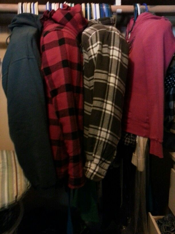 When moving hanging clothes, use jackets to keep them together and save on trash bags. Courtesy of barbie Eldred