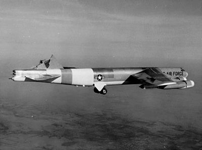 Black-and-white photo of a B-52 inflight with its vertical stabilizer sheared off. B-52H (61-0023), configured at the time as a testbed to investigate structural failures, still flying after itsvertical stabilizer sheared off in severe turbulence on 10 January 1964. The aircraft landed safely