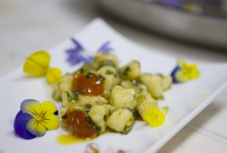 hand made gnocchi with local herbs pesto and flowers