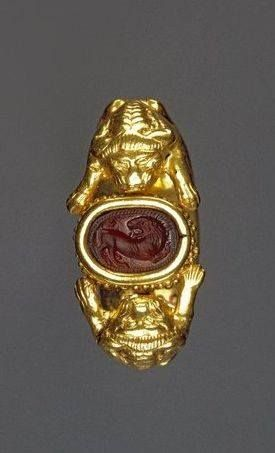 Etruscan golden ring with carved lion intaglio. 5th Century BCE.