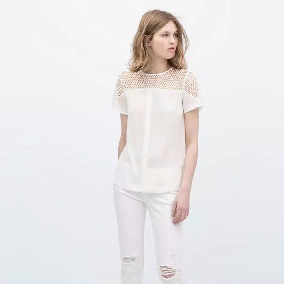 """Lace Chiffon Loose Blouse NWT Super elegant white loose fitting blouse features O-neck, lace details around shoulder area & trim, back key-hole with one button closure. It looks great with jeans or ellegant dark-blue cigarette trousers. Made of lace & chiffon. Size fits XS/S. Measurements laying flat approximately: shoulder 14.5""""; sleeve 7.8""""; bust 36""""; waist 38""""; length 25"""". Please use the measurements as a guide to see if this will fit you. Brand new with tag! Boutique Tops Blouses"""