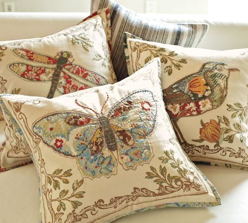 These are from Pottery Barn but wouldn't this be a great way to show-case vintage quilted pieces?  You could make the back of the pillow & the design out of pieces of a quilt and then finish it off with embroidery.