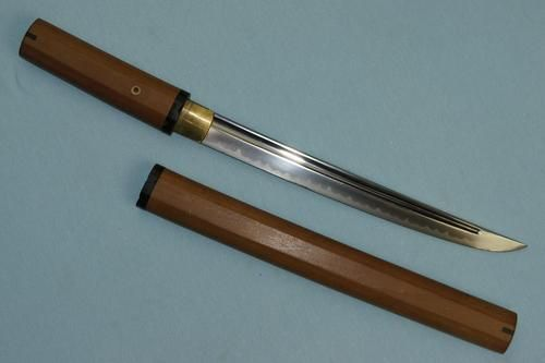 """Classical Tanto - notice the more rounded, less aggressive shape.  Probably, the reason why the modern knifemakers called their fighting knives """"tantos"""" was to invoke the exotic mystique of feudal Japan.  You might be old enough to remember that was a huge craze for ninjas and samurais in the 80s.  In sum, the typical Japanese tanto is simply a general-purpose knife, whereas the """"American tanto"""" is specifically designed for piercing through armor, heavy clothing or bone."""