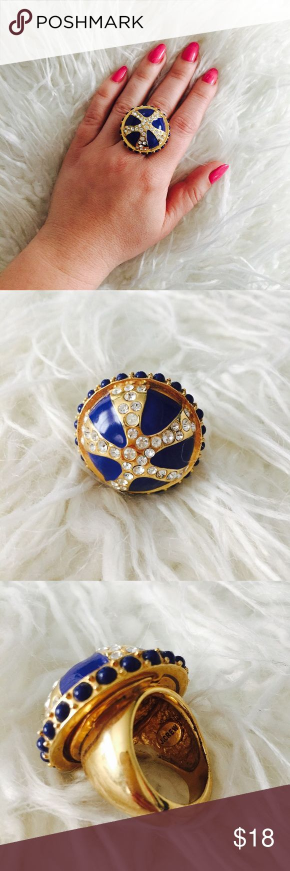 J. Crew Enamel and Rhinestone Ring This ring is a show stopper. Gold with blue enamel and rhinestone details. One size. I have fairly small hands and this fits great on my middle finger and would fit great on the ring finger for those with larger hands. The top of the ring measures 1.5 inches in diameter. There are a couple very small spots of tarnishing on the interior of the band (pic 3) but ring is otherwise in great condition with all rhinestones intact. J. Crew Jewelry Rings