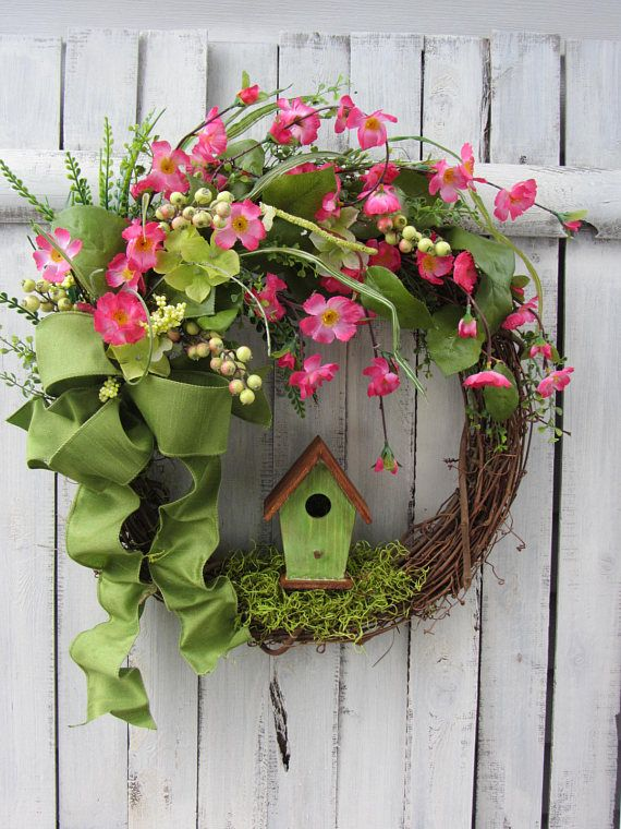 Pink Spring Wreath - Summer Wreath - Birdhouse Wreath - Rustic Spring Wreath - Primitive Wreath - Mothers Day - Primitive Country Wreath    Bright pink spring wreath with a rustic green birdhouse on a grapevine wreath. Has small pink flowers, artificial greenery, mosses, berries, & wired green bow.  Wreath dimensions are: 24 inches in wide; 21 inches tall ; 8 inches deep.