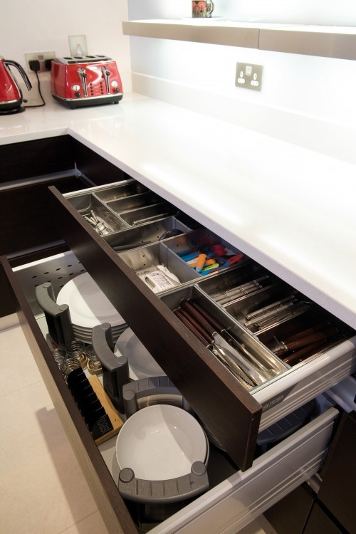 Caddies for dishes work great if you don't have a ton of wall cabinets. Plus, these handy ones can be picked up and brought to the dishwasher for unloading or to the table for setting.