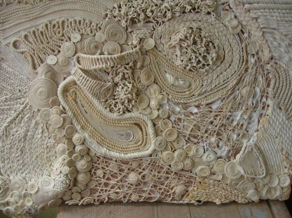 Amany Soliman, artist and professor at Helwan University in Cairo, Egypt. Amany specializes in beaded jewelry and the arranged textile