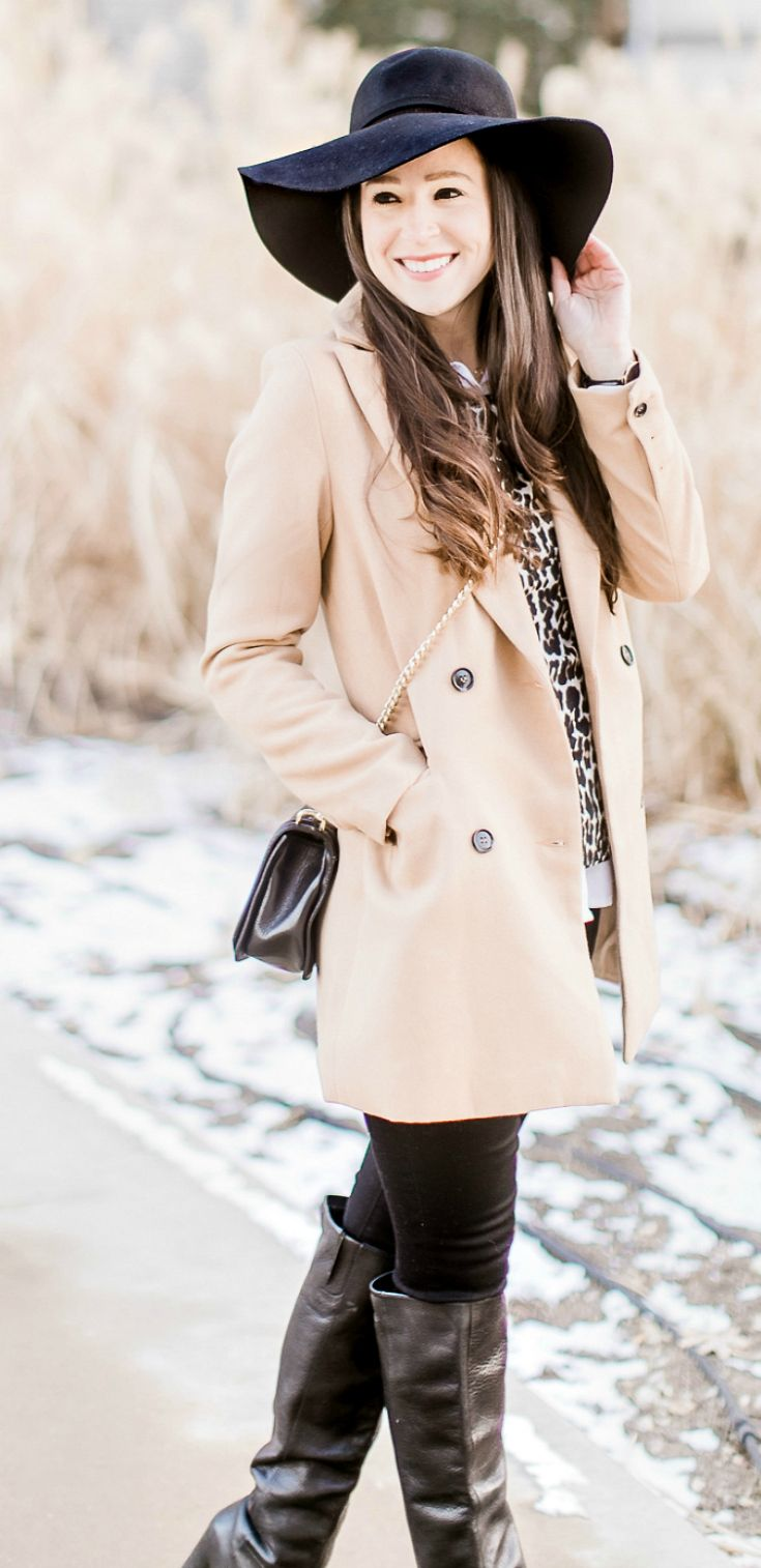 Cute camel coat under $50 | SheIn Camel coat styled with Mott and Bow black skinny jeans, J.Crew Factory leopard crewneck sweater, Nine West tall black leather boots, black floppy hat, Daniel Wellington Classic Black Sheffield Watch, and Rebecca Minkoff Love Crossbody Bag | Cheap winter coats online | Braving Winter on a Budget: Affordable Camel Coats under $100 by southern fashion blogger Stephanie Ziajka from Diary of a Debutante