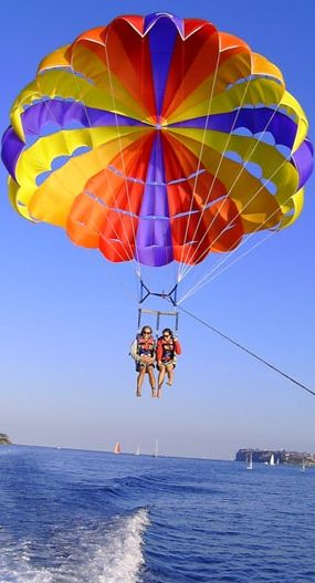 "Parasailing. ~ I did this many years ago on a trip to Acapulco - photos taken and when we got home and showed them to our four children they could not believe it was their mom, they were so funny saying, ""Way to go, Mom!"""