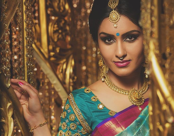 South Indian bride. Gold Indian bridal jewelry. Temple jewelry.Jhumkis. Pink Kanchipuram silk saree.Braid with fresh flowers. Tamil bride. Telugu bride. Kannada bride. Hindu bride. Malayalee bride.Kerala bride.South Indian wedding.