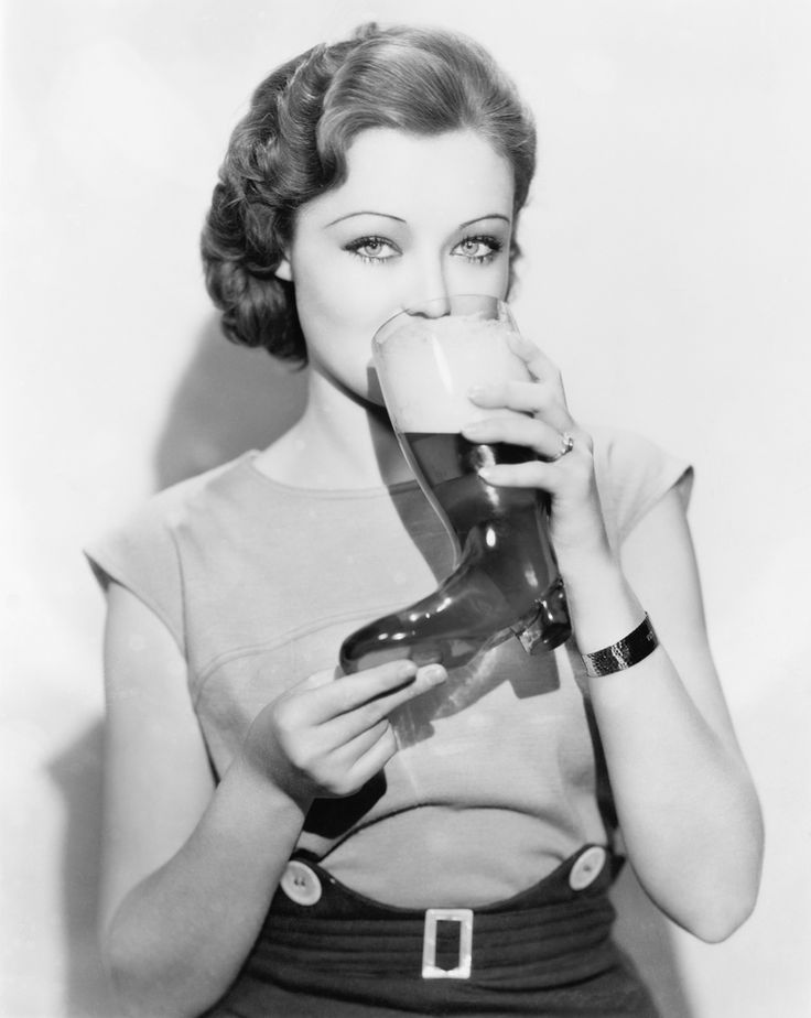 Lona Andre, enjoying a Beer Boot. Photo from the 1940s.