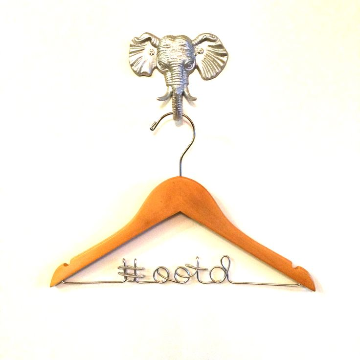 """A custom children's hanger is a stylish and unique way to organize daily outfits and display your toddler's fashion! This hanger is customized with the phrase #ootd, which is a social media abbreviation for """"outfit of the day."""" The wooden hanger measures 13"""" and has notches to keep a dress in pla..."""