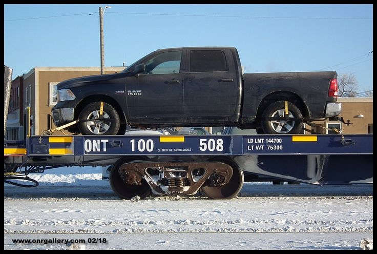 """Here's a look at Ontario Northland's new """"strap"""" car system doing what it was built to do holding down a Dodge Ram 150 to the deck of 100508 on a very cold February 6th at Cochrane."""