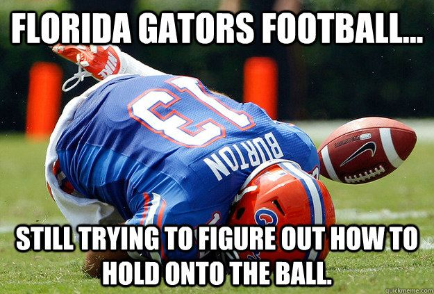 Still trying to figure out how to hold onto the ball! lol the sad thing about this is i am a Gator fan lol