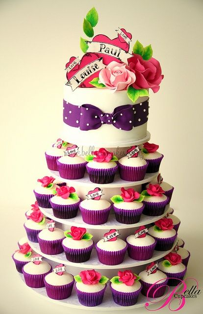 I love just the plain white cake with the purple polka dotted ribbon around it.