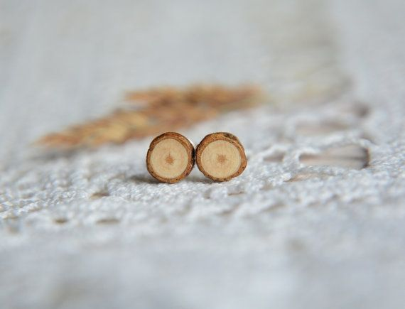 Minimalist and raw wooden earrings made from a fallen tree branch. They are cut into slices, saned and cover with varnish for protection. These