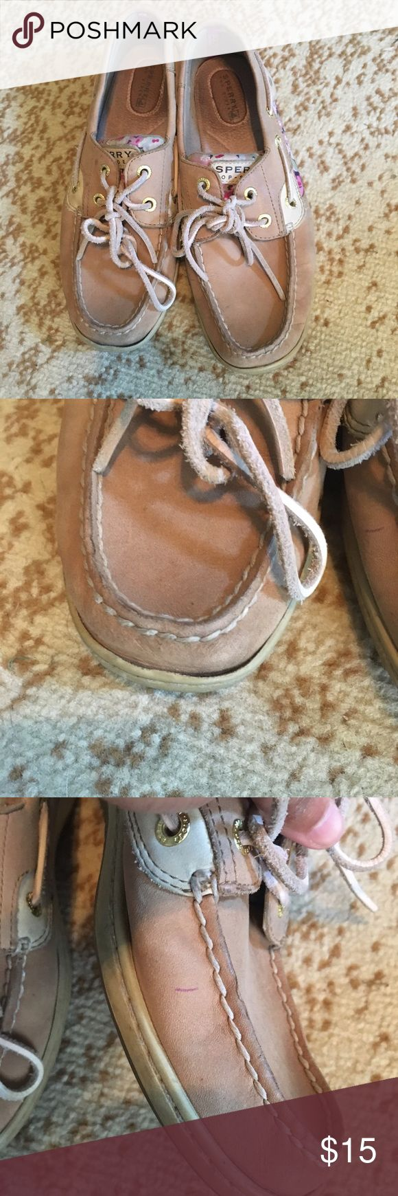Floral sperrys Floral sperrys. Wear on the heels, sides with some pen marks as shown, a couple spots on the top of one of the shoes and the sole is coming up on one of the shoes as pictured. Size 7. Price is negotiable and ships next day. Sperry Shoes