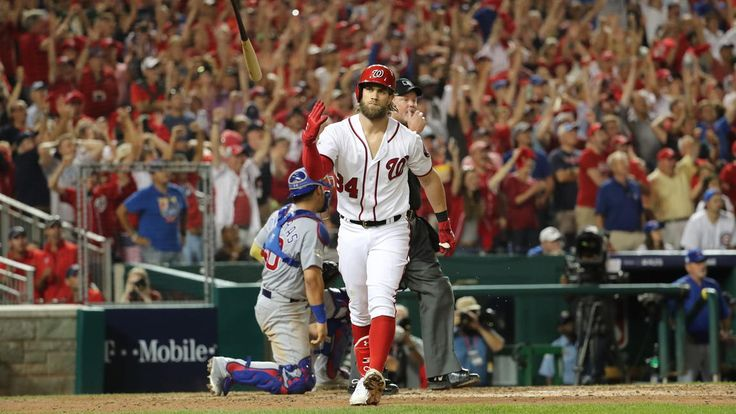 October 7, 2017:  NLDS Game 2: Cubs-Nationals   - Nationals right fielder Bryce Harper (34) flips his bat after hitting a two-run home run in the eighth inning.
