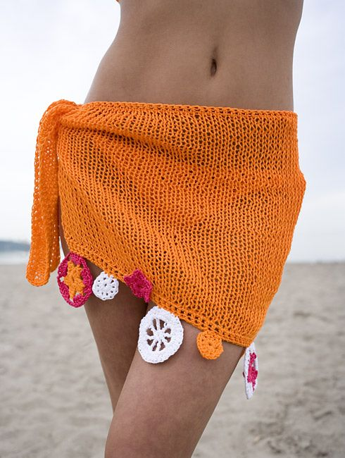 Free Knitting Pattern for Summer Sarong - Joanne Yordanou's easy cover-up knit wrap skirt is embellished with crochet motifs that are easy to make. Matching bikini pattern also available