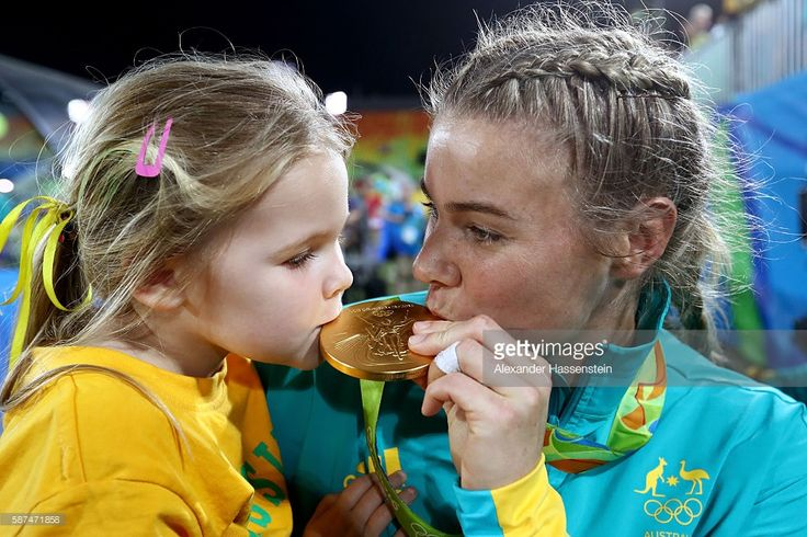 Nicole Beck of Australia kisses her Gold medal with her daughter Sophie Beck…